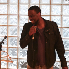 Asante Haughton performing at Open Mic Night