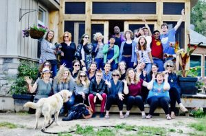 A group photo of Stella's Place staff gathered on a front porch