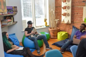 3 people sitting on beanbags in Stella's Place Café