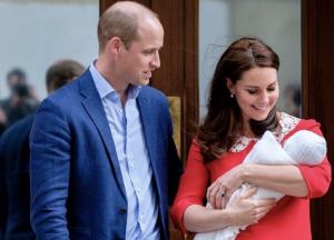 The Duke and Duchess of Cambridge holding baby