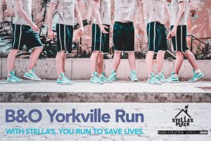 """A photo of y figures, all wearing black shorts, a beige shirt and blue sneakers. The photo is taken from the waist down and overlaid on the ground at the bottom is text that reads """"B&O Yorkville Run"""" and subheading underneath """"with Stella's, you run to save lives"""""""