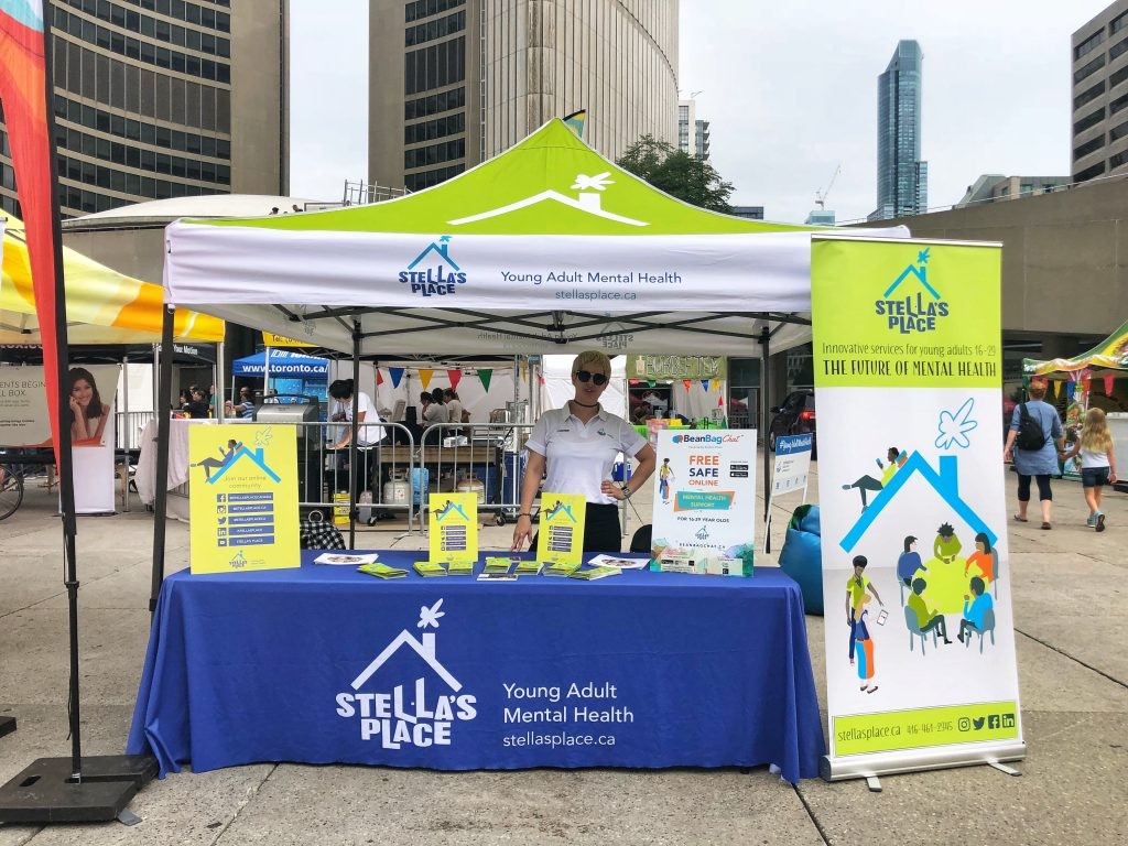 Liz Reppin' Stella's Booth at Nathan Phillips Square