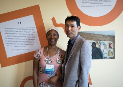 Carol Clarke and John Choi standing together for a picture