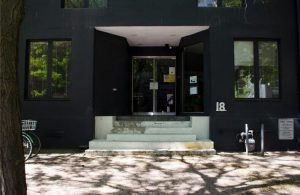 Photo of Stella's Place building front entrance, taken from the street on a sunny summer day