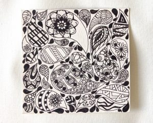 A white square canvas covered in every corner with black marker doodles and designs.