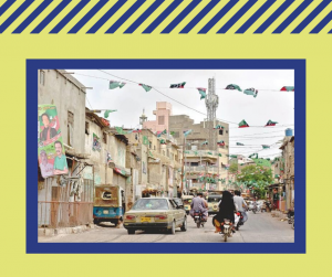 A photo of a street view in Pakistan. The photo is framed with a purple border and a light green frame around.