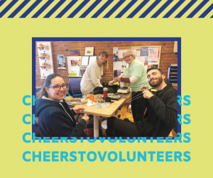 """Group photo in Stella's Place cafe on green background with purple graphics and text that reads """"Cheers to Volunteers"""""""