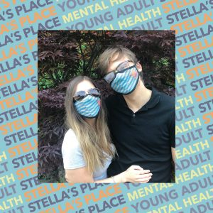 Photo of two people wearing Stella's Place mask, blue patterned background