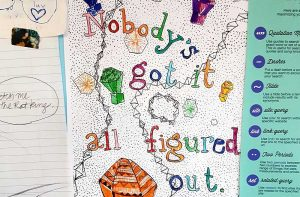 """A piece of artwork with lots of colours and doodles with letters that read """"Nobody's got it all figured out."""""""