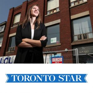 A photo of Robyn Whitwham looking up and into the distance with the Stella's Place building behind and underneath is the blue Toronto Star logo