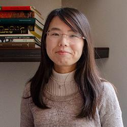 A portrait of Megumi in the Stella's Place café.