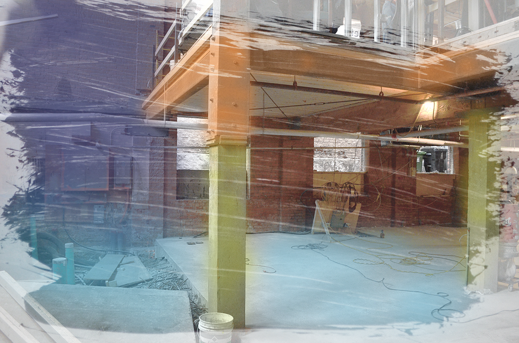 A photo of a room under construction with digital paint strokes layered overtop in colours of blue, green, orange and purple.