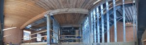 A panorama view of the ceiling and support beams of 54 Wolseley under construction.